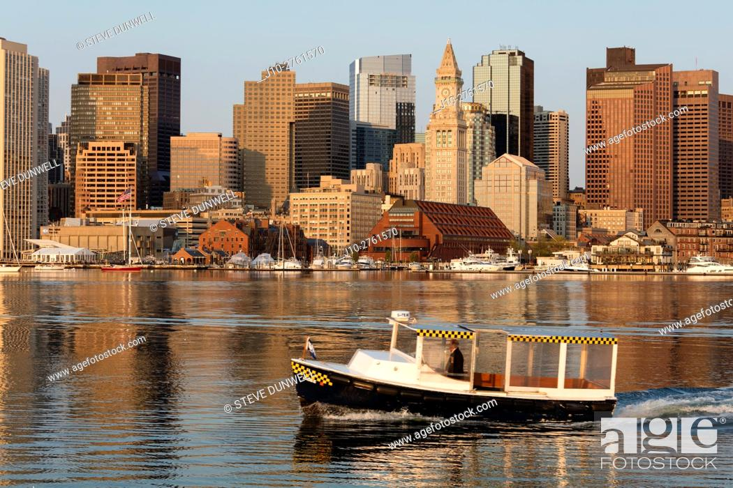 Stock Photo: Water taxi ferry, skyline view from East Boston, Massachusetts, USA.
