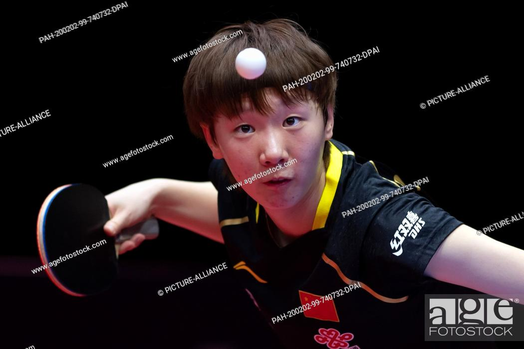 Stock Photo: 02 February 2020, Saxony-Anhalt, Magdeburg: Table tennis: German Open, women, singles, semi-finals, Ding (China) - Wang (China). Wang Manyu in action.