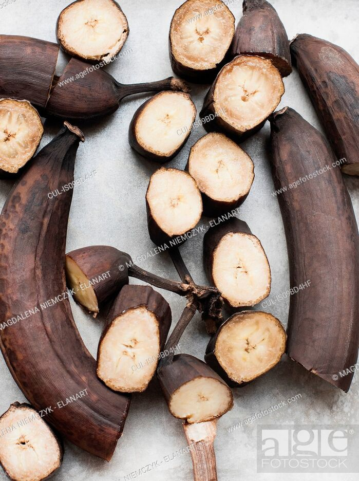 Stock Photo: Still life of rotting bananas, sliced and whole, overhead view.