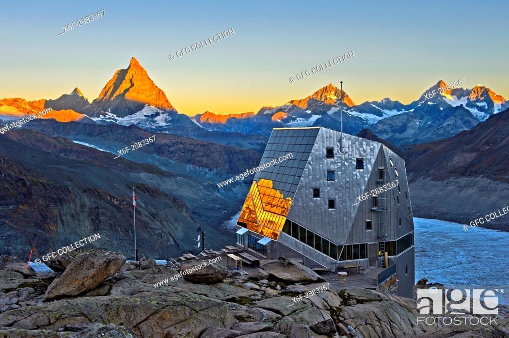 Photo de stock: Dawn at the Monte Rosa Hut, Monte Rosa Hütte, above the glacier Gornergletscher, first sun rays at the top of the Matterhorn peak, Zermatt, Valais, Switzerland.