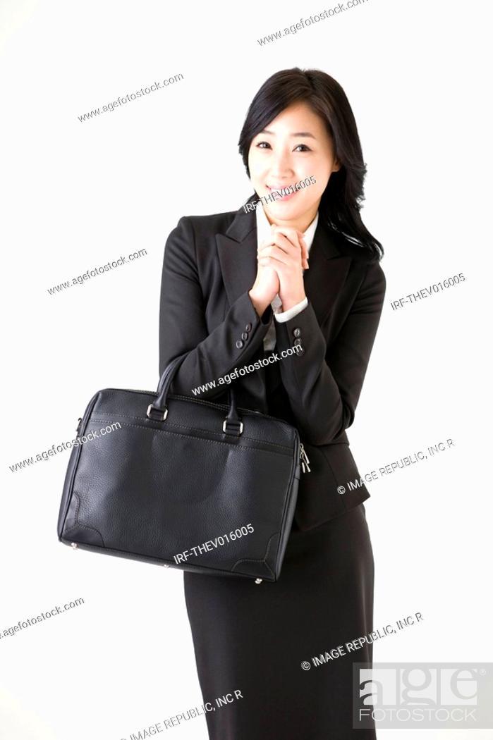 Photo de stock: businesswoman holding a briefcase.