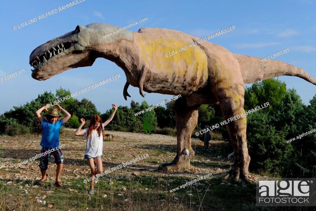 Imagen: Croatia, Cape Kamenjak, boy and girl having fun at dinosaur educational trail.
