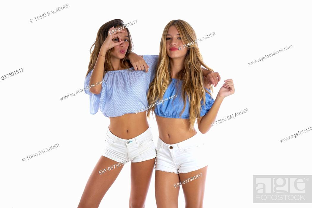 Stock Photo: Teen best friends girls happy together looking through finger goggles.