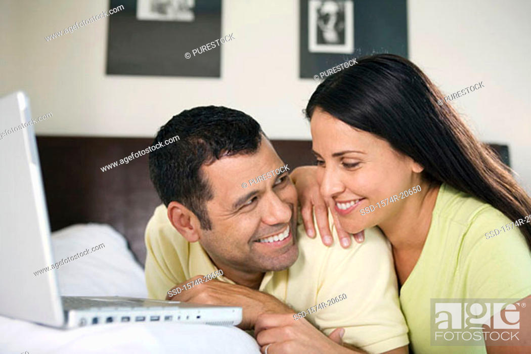 Stock Photo: Close-up of a mature couple looking at each other and smiling.