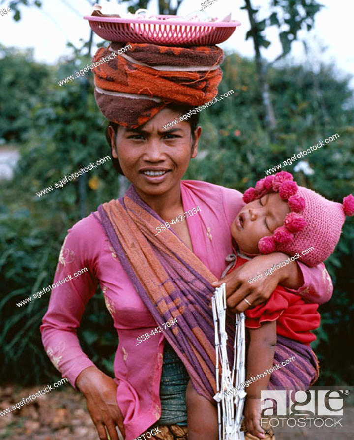 Woman Vendor With Baby Kintamani Market Bali Indonesia Stock