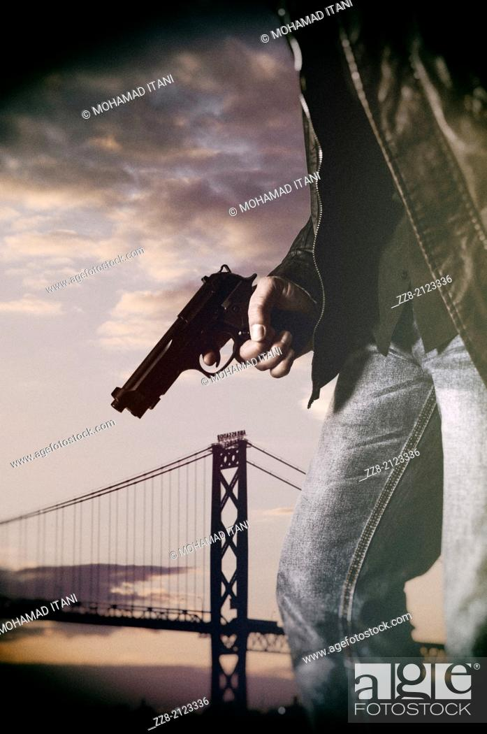 Stock Photo: Man holding a gun.