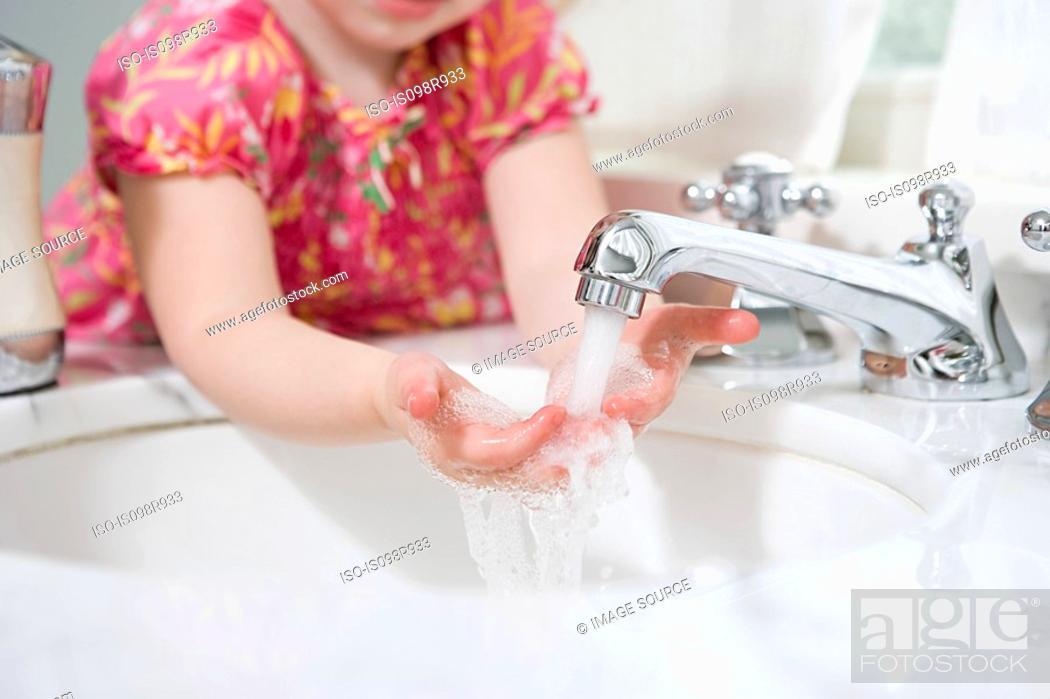 Stock Photo: Girl washing her hands.