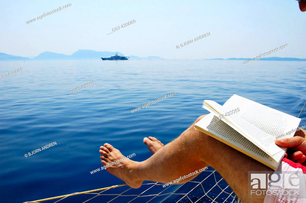 Stock Photo: Reading aboard a yacht i Greece.