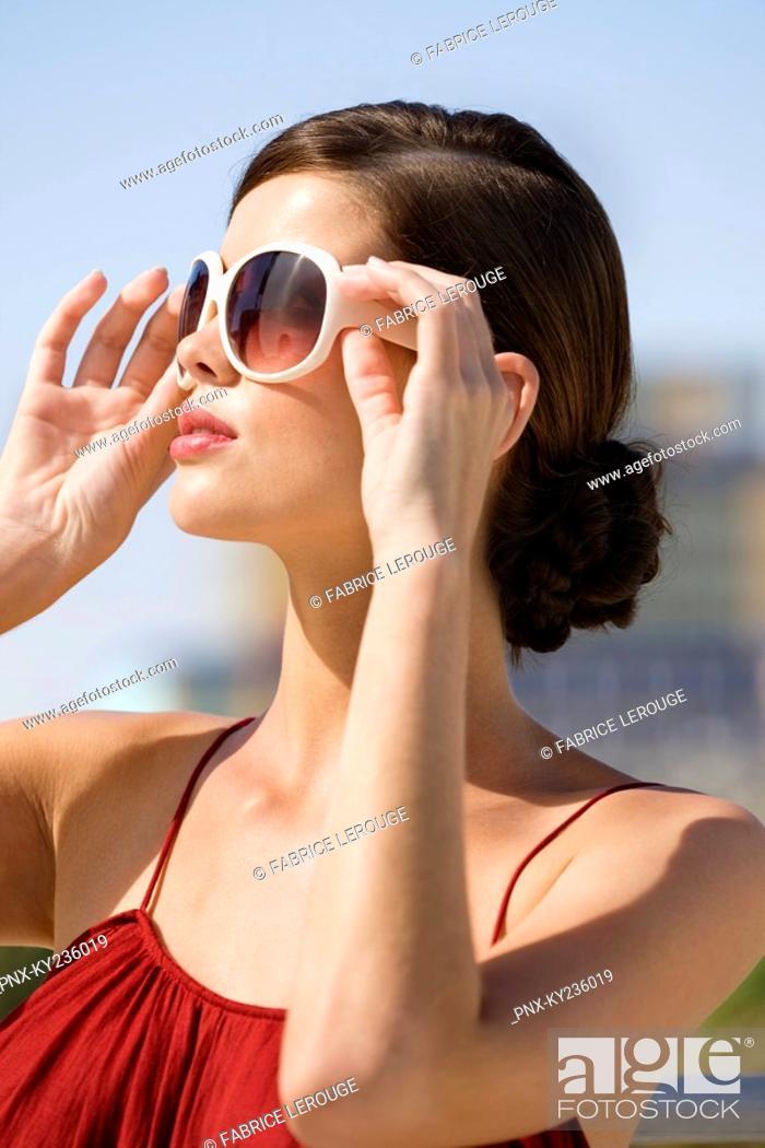 Stock Photo: Fashion model wearing sunglasses.