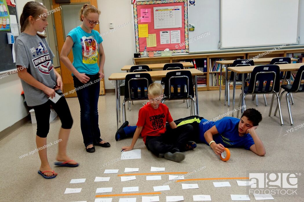 Stock Photo: 6th Graders Solving Math Problem With Manipulatives, Wellsville, New York, USA.