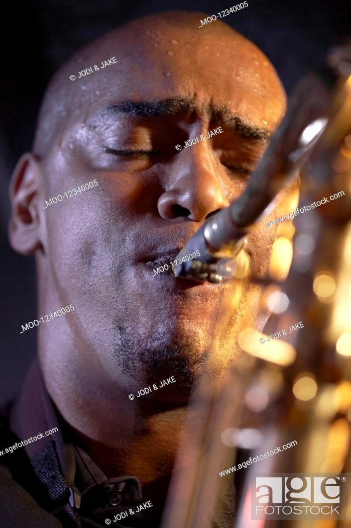 Stock Photo: Saxophone player on stage portrait close-up.
