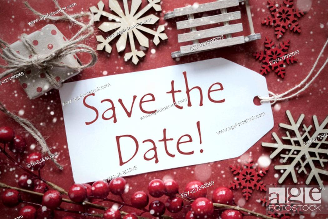 Stock Photo: English Text Save The Date. Nostalgic Christmas Decoration Like Gift Or Present, Sleigh. Card For Seasons Greetings With Red Paper Background.