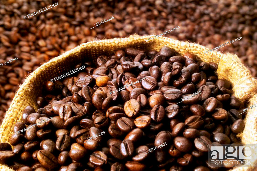 Stock Photo: Coffee beans, some in a sack.