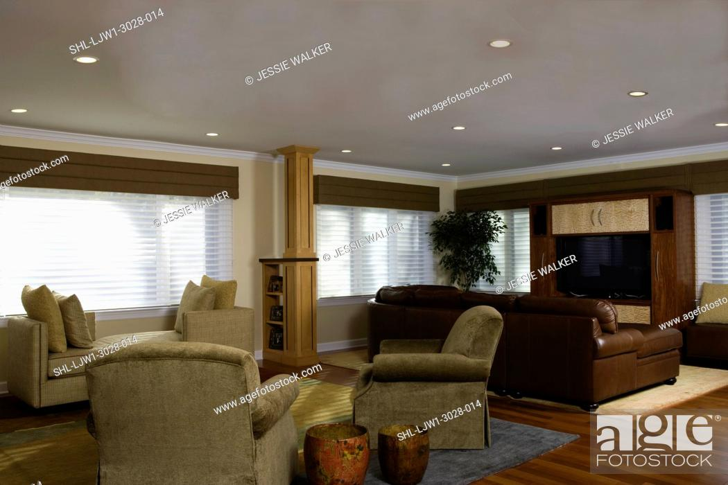 Stock Photo: FAMILY ROOM: Open concept family room with media center and a sitting area divided by a Craftsman style column and buil- tin shelving, earthy colors,.