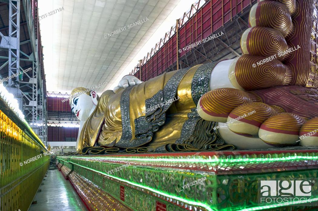 Stock Photo: Myanmar (formerly Burma). Yangon (Rangoon). The Kyaukhtatgyi Pagoda is home to a large 70 meter long lying Buddha. His feet plants bear the 108 sacred marks.