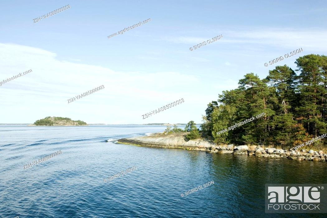 Stock Photo: Seascape with forested islands.