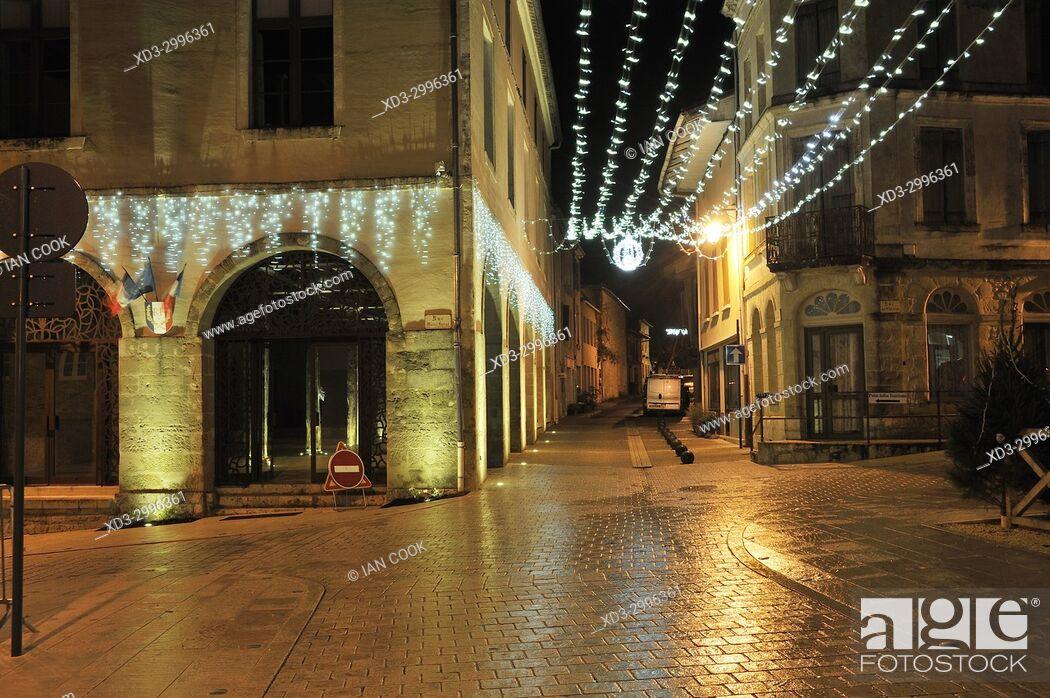 Stock Photo: village of Lauzun at night with Christmas lights, Lot-et-Garonne Department, New Aquitaine, France.