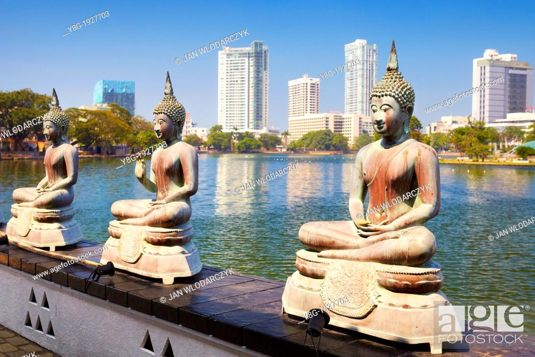 Stock Photo: Sri Lanka - Capital City Colombo, Buddha Statues in Seema Malaka Temple on Beira Lake, 'World Trade Center' in the background , Sri Lanka, Asia.