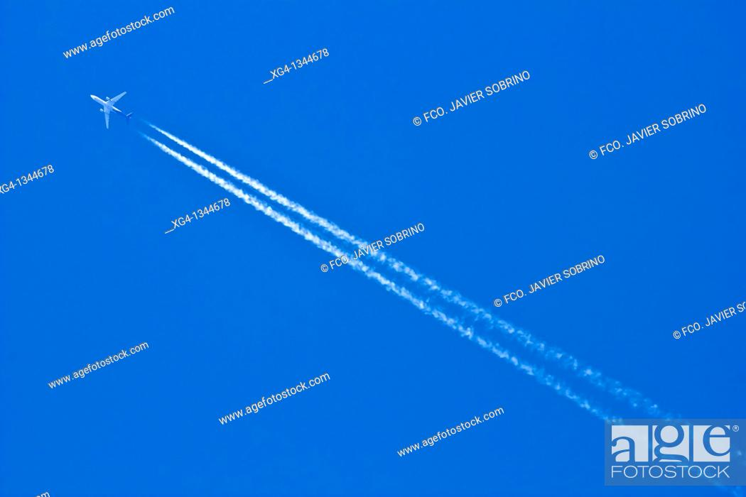 Stock Photo: Plain and contrail.