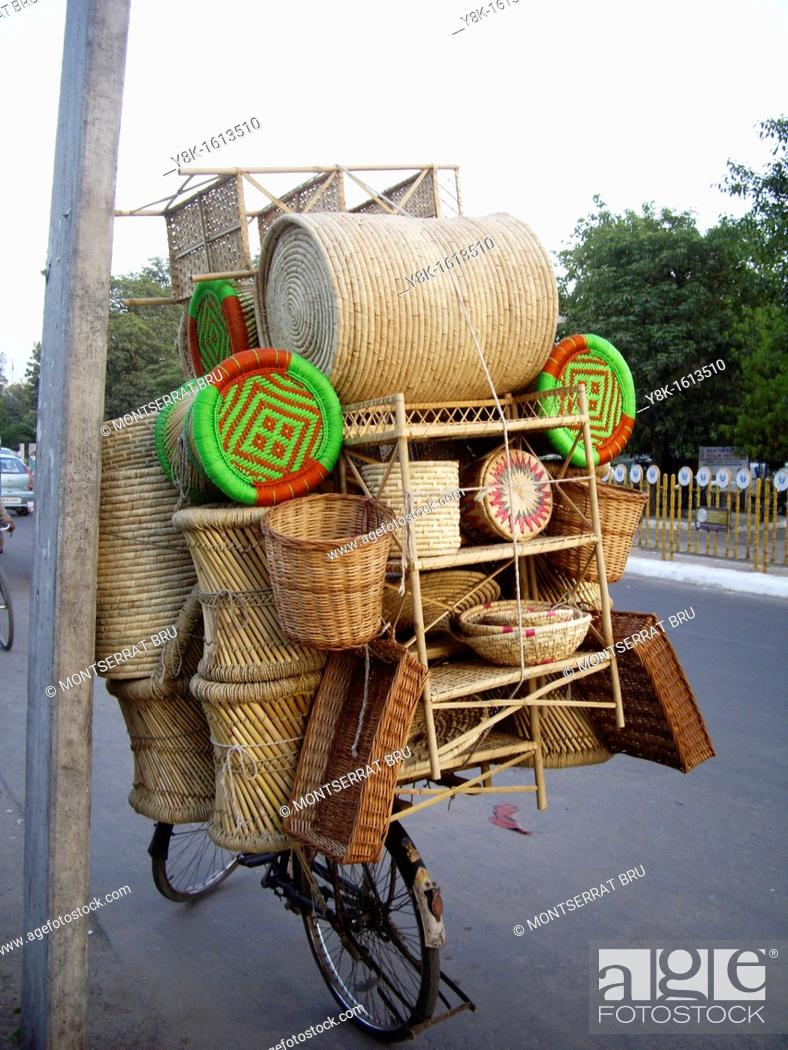 Stock Photo: Basketwork shop on cycle in Defence Colony, New Delhi, India.
