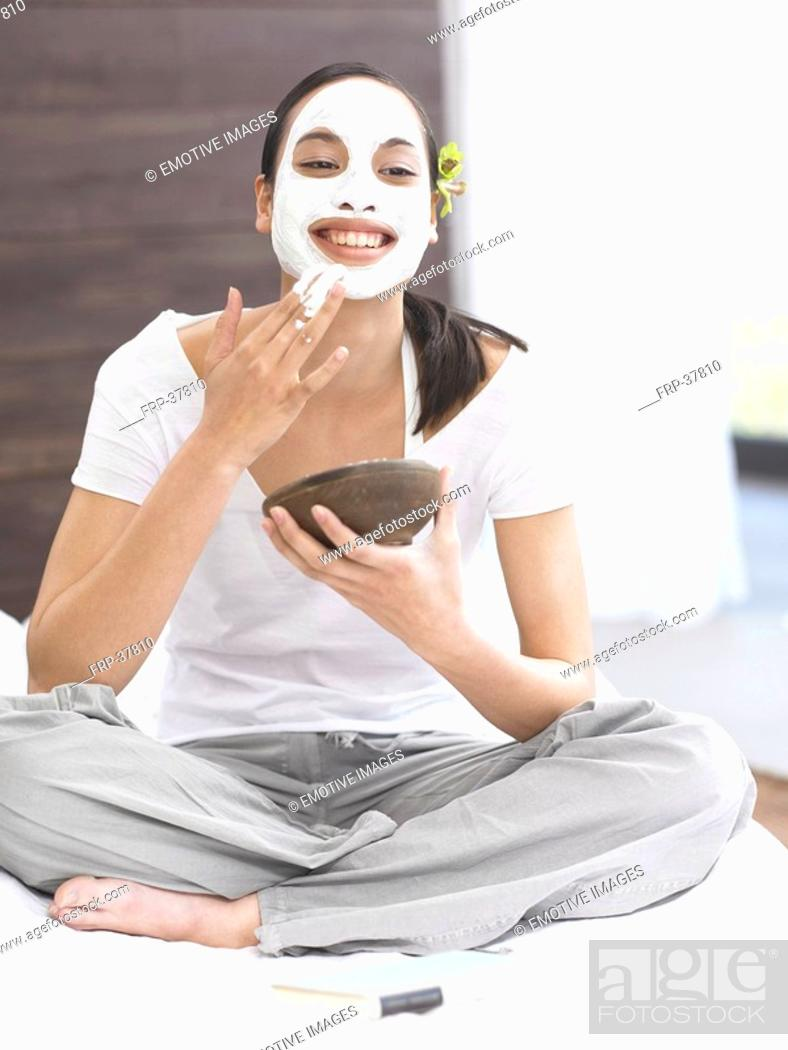 Stock Photo: Dark-haired woman with face mask.