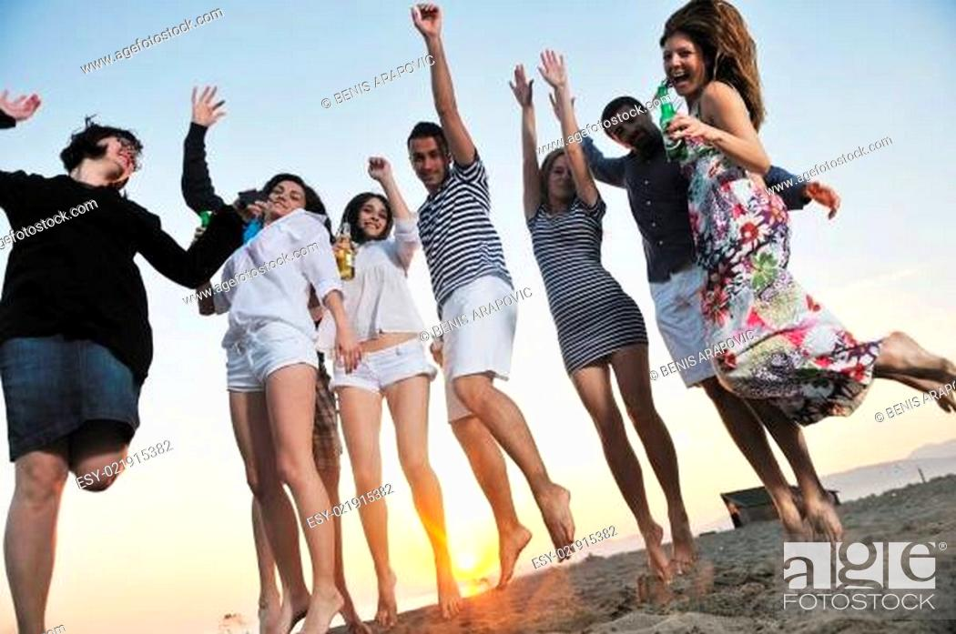 Stock Photo: Group of young people enjoy summer party at the beach.