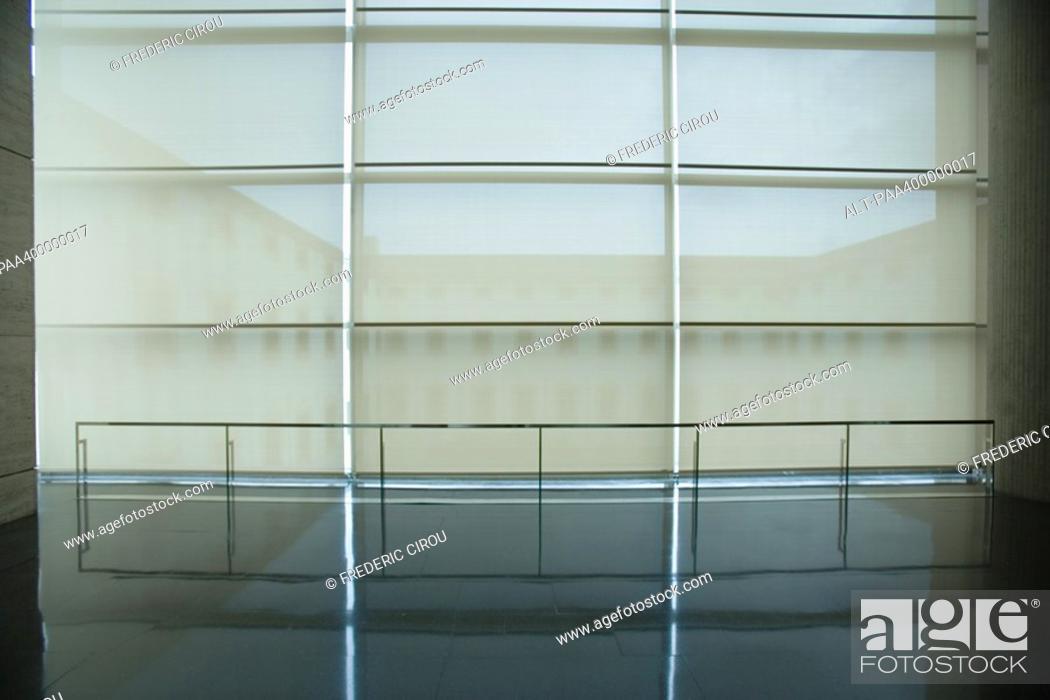 Stock Photo: Architectural detail, courtyard seen through shades.