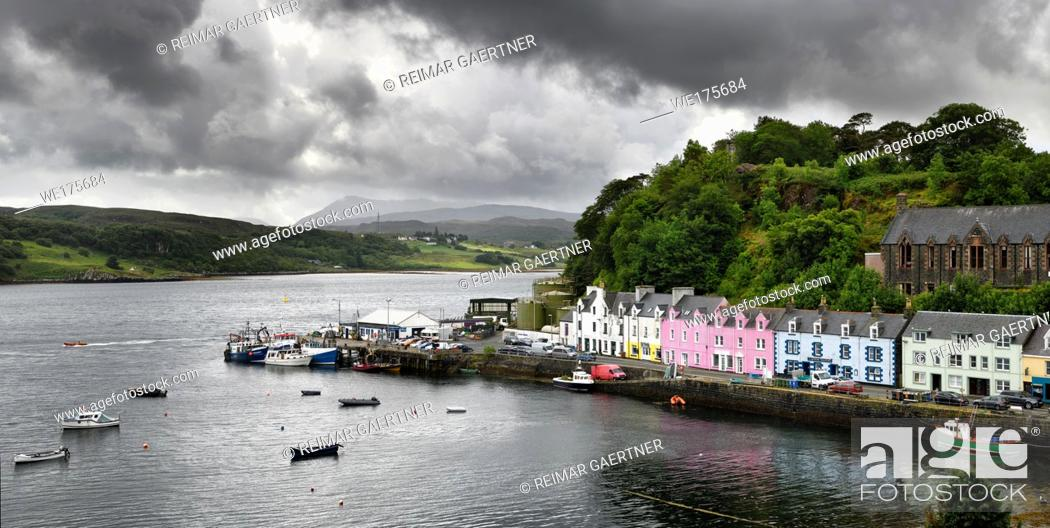 Stock Photo: Colorful houses on Quay street of Portree Harbour on the Isle of Skye Inner Hebrides Scottish Highlands Scotland with boats and dark clouds.
