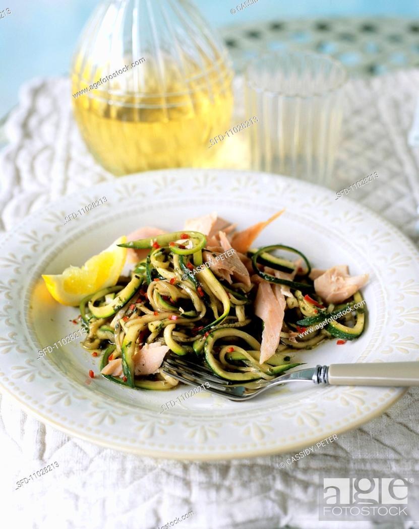 Stock Photo: Smoked trout with courgette strips.
