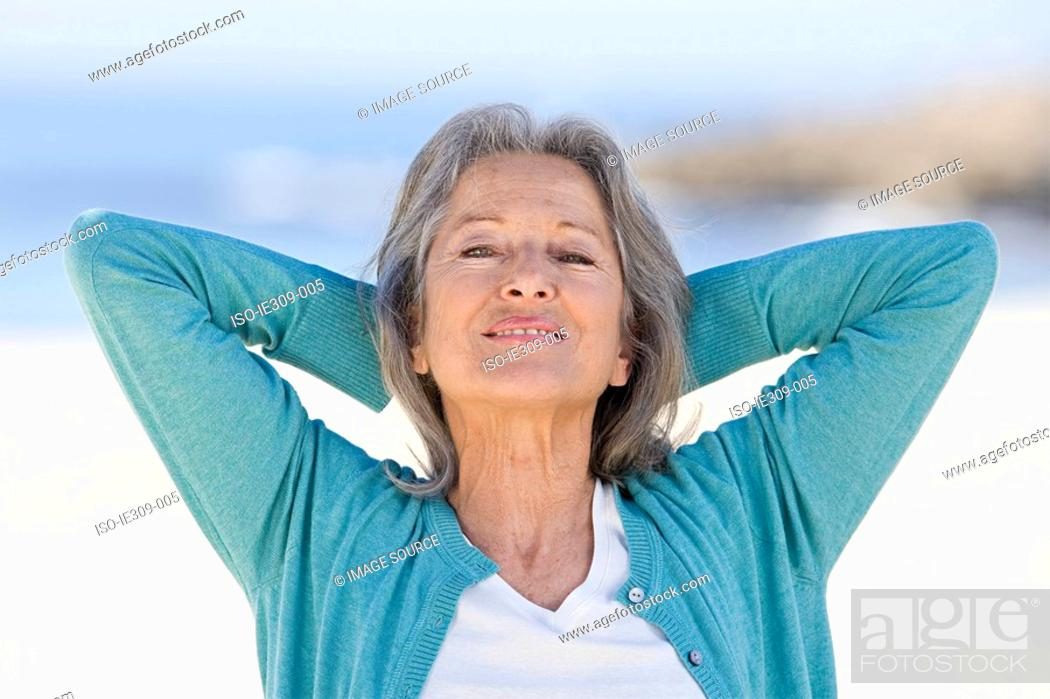 Stock Photo: Senior woman with hands behind her head.