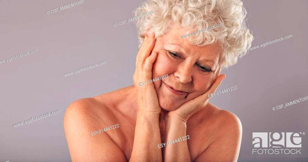 Stock Photo: Elderly woman brings back memories of young age.