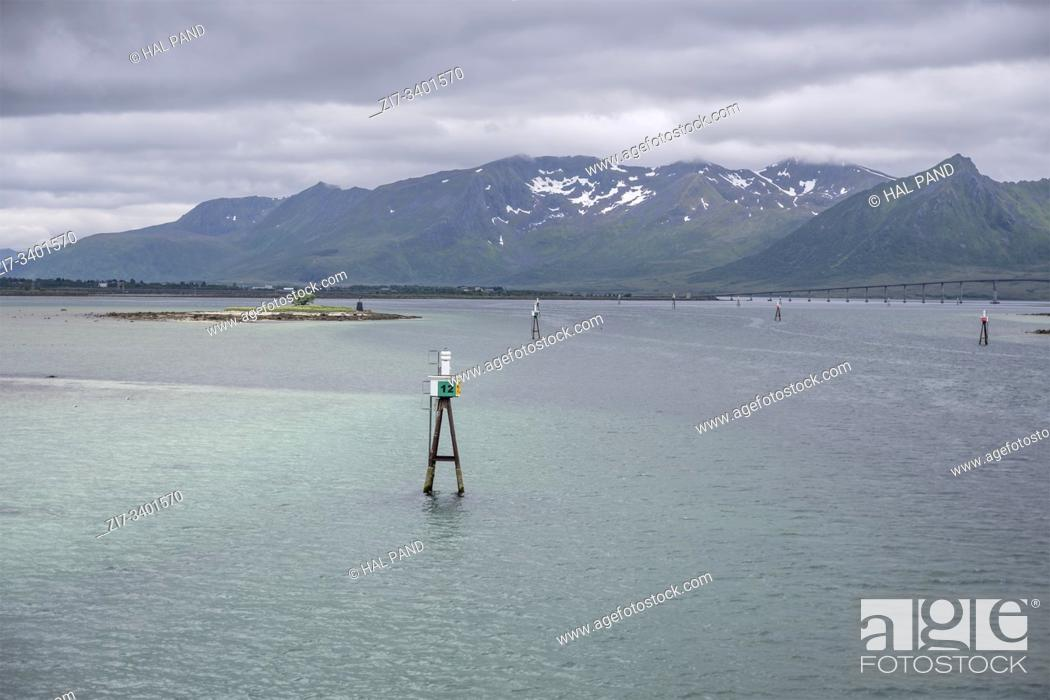 Stock Photo: Artic circle fjord landscape with bouys marking man-made navigation canal in shallow waters, shot under bright cloudy light at Rysohamn, Andoya, Vesteralen.