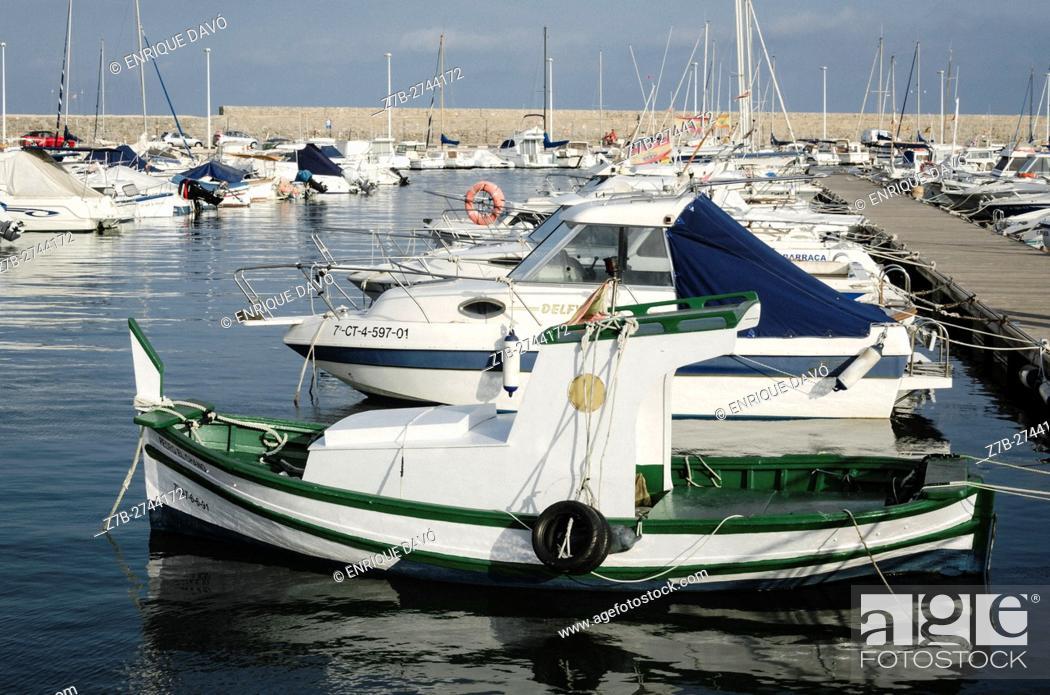 Stock Photo: A green boat view in the Altea port, Alicante, Spain.