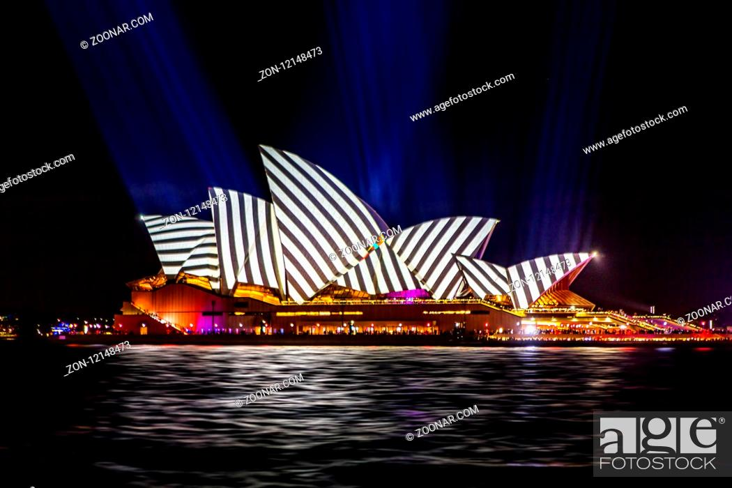 Stock Photo: Sydney, Australia - May 25, 2018; Sydney Opera House lit with vibrant colours geomeric patterns and motion graphics during the Annual Vivid Sydney celebrations.