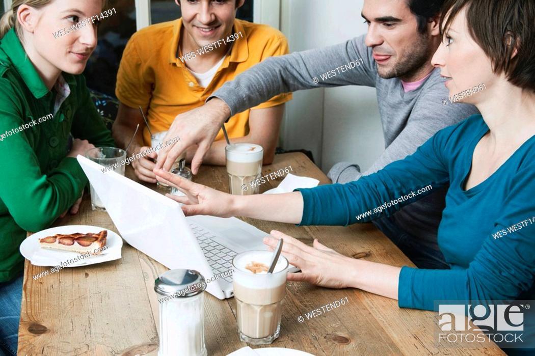 Stock Photo: Friends using laptop.