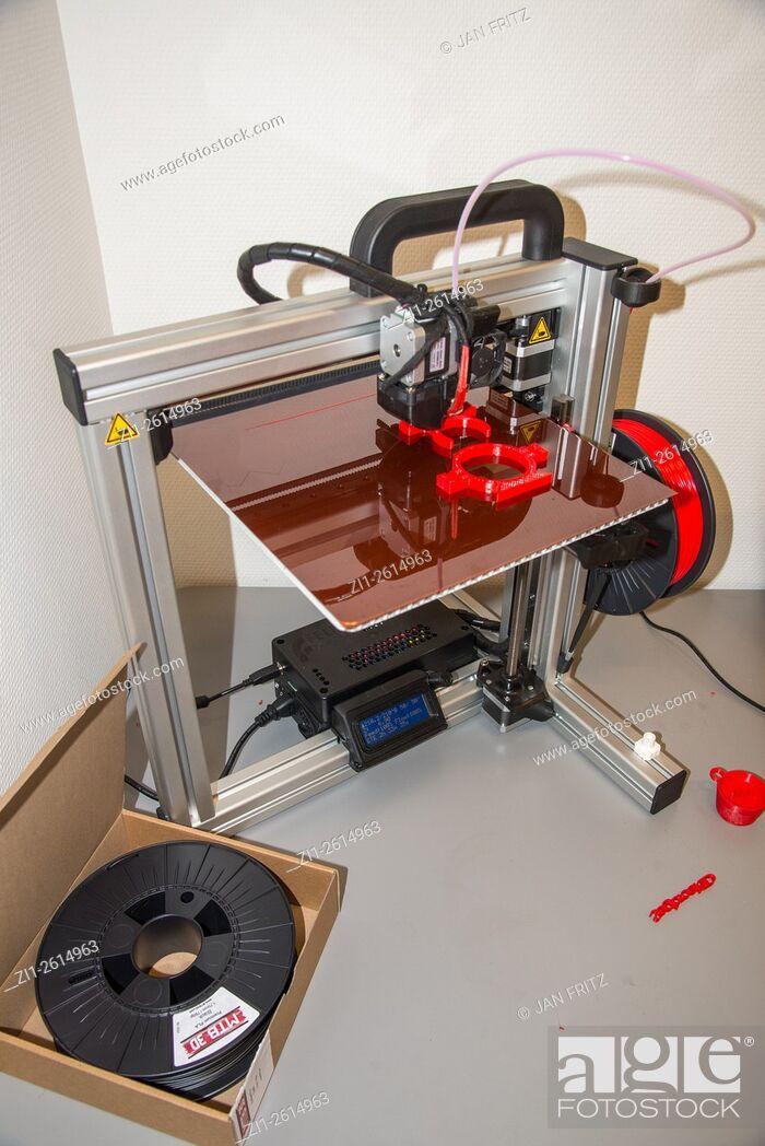 Stock Photo: 3 dimensional printer at work.