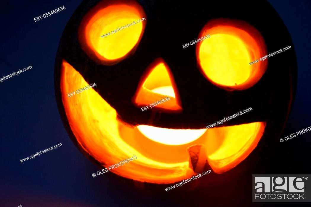 Stock Photo: Lighted pumpkin-shaped candle for halloween the burning.
