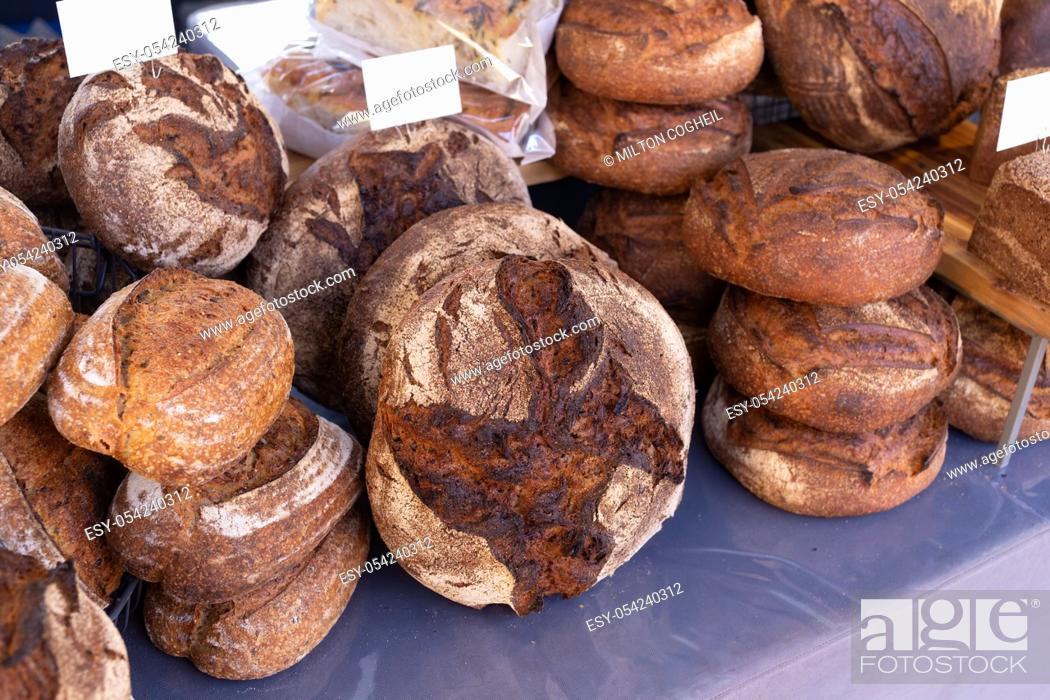 Stock Photo: Freshly baked rustic rye granary bread on a food market stall.
