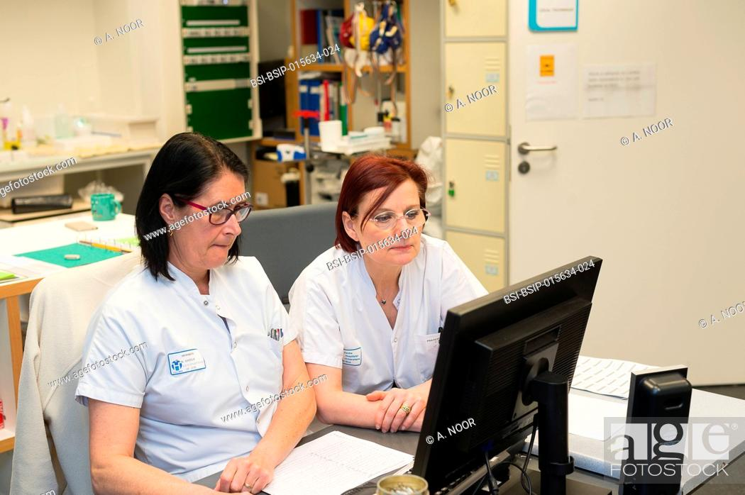 Stock Photo: Reportage in the epileptology unit in Nice Hospital, France. A nurse and doctor in the control room. The control room is used during long-term EEGs.