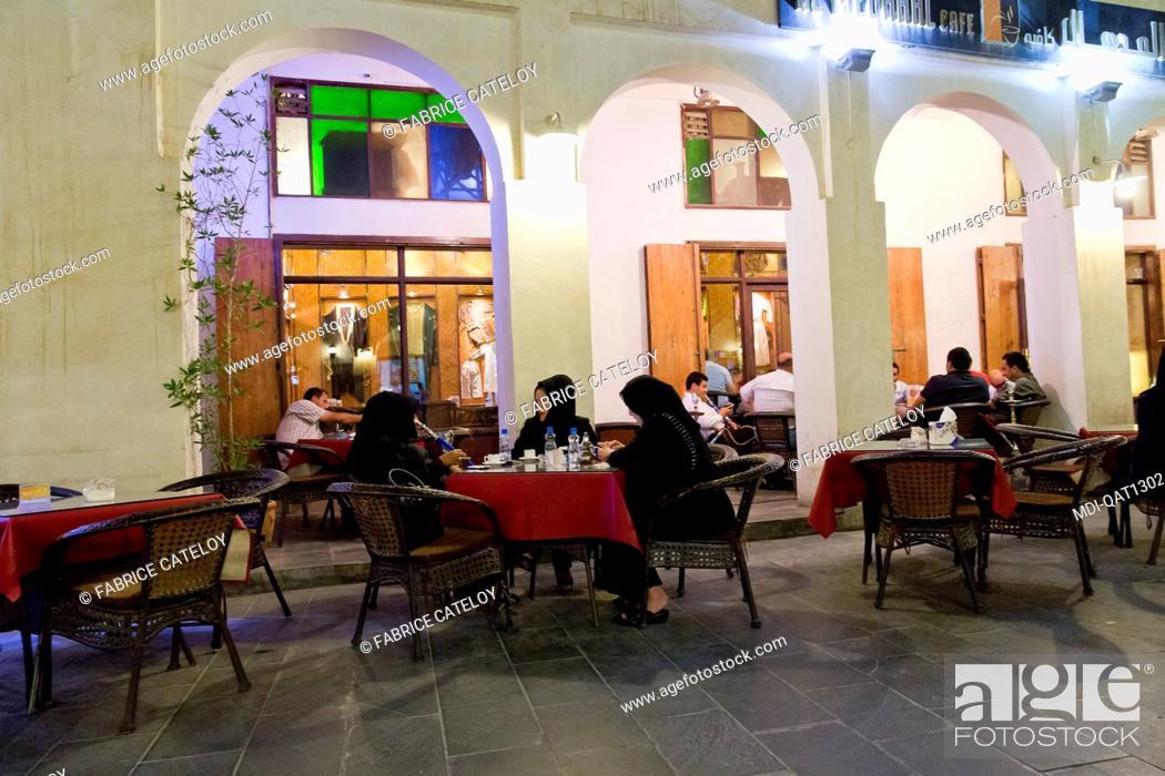 Imagen: Qatar - Doha - Souk Waqif - Qatari on the terrace of a restaurant.