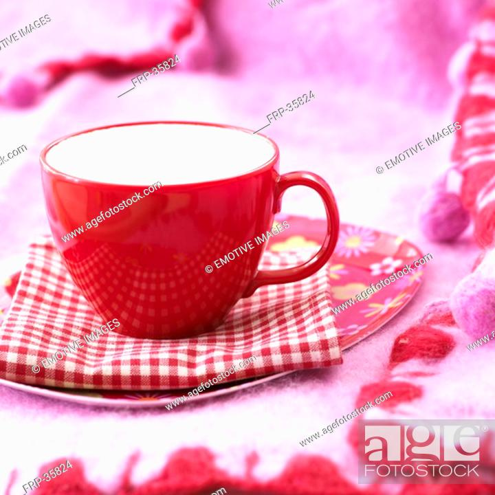 Stock Photo: red cup on chequered napkin.
