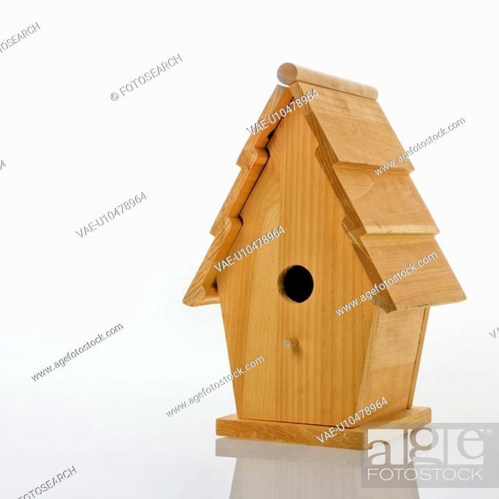 Stock Photo: Wooden birdhouse against white background.