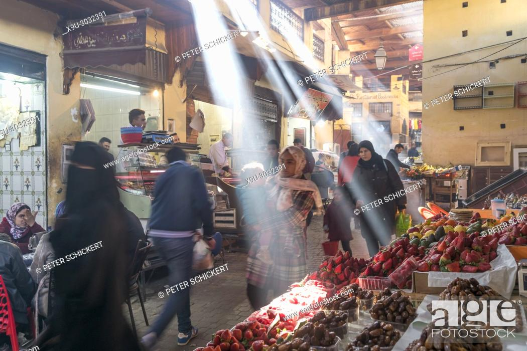 Stock Photo: sun rays reaching the souk in Fes, Kingdom of Morocco, Africa.