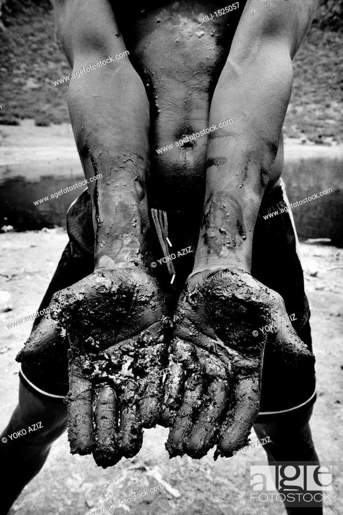 Stock Photo: Salt extraction in the El Sod crater, Ethiopia.