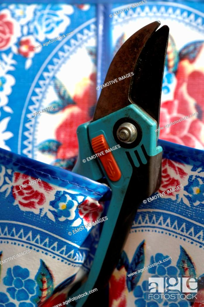 Stock Photo: Secateurs in a pocket.
