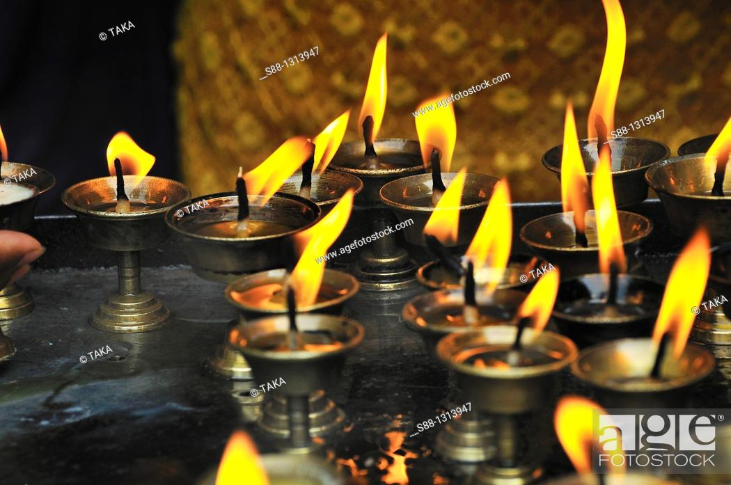 Stock Photo: Candle flames at the temple.