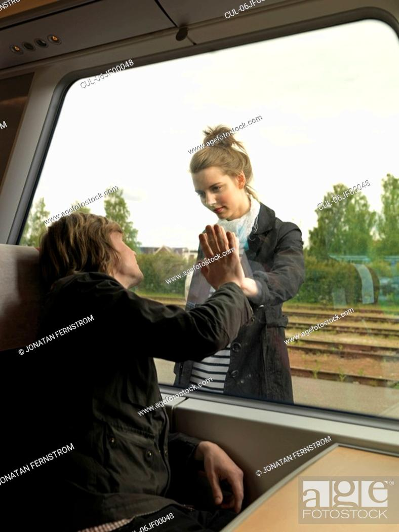 Stock Photo: Young couple on train.