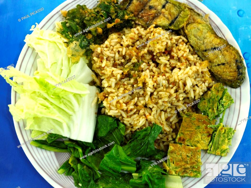 Stock Photo: spicy rice with chilli paste with mixed vegetables and chive omelette, food court , bangkok, thailand.