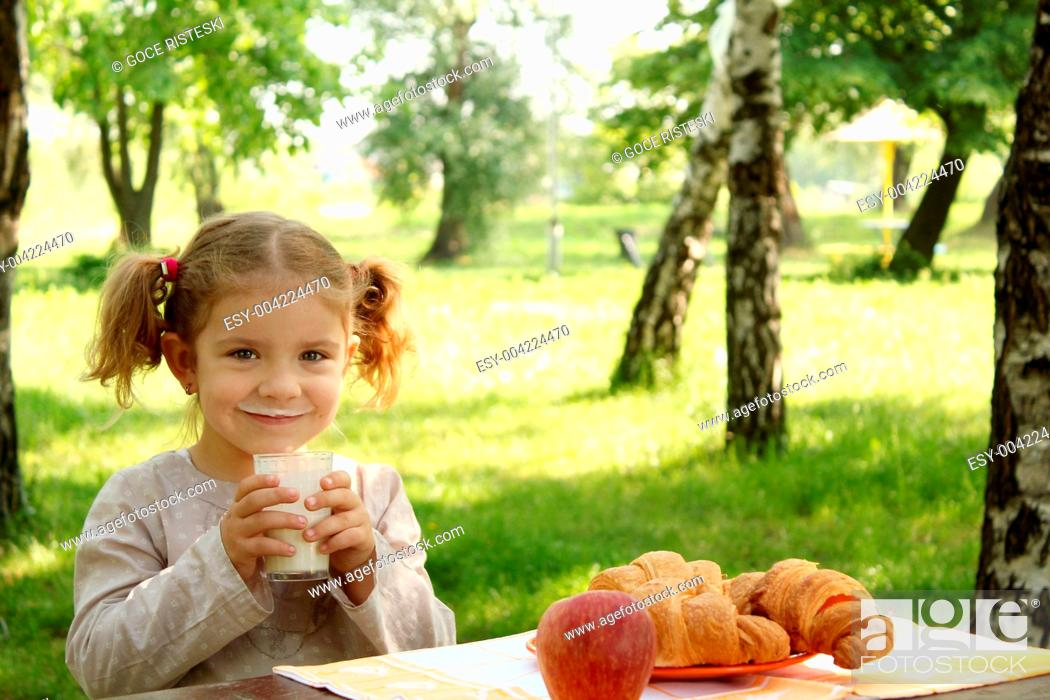Stock Photo: young girl drink milk.