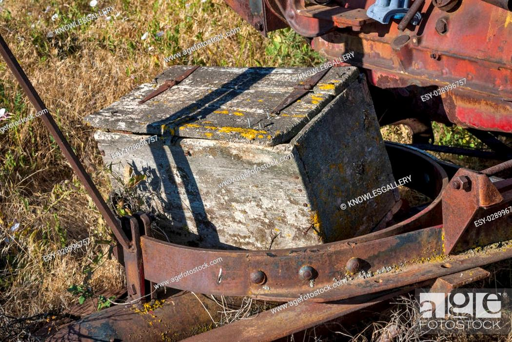 Stock Photo: Abandoned on an old combine a wooden tool box is weathered.